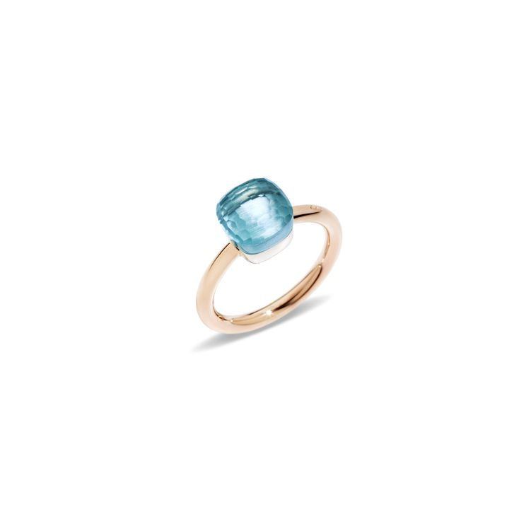 Petit ring in rose and white gold with blue topaz