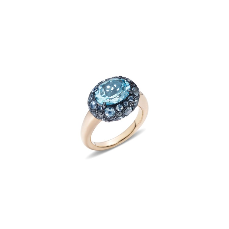 Ring in rose gold and silver with blue topazes