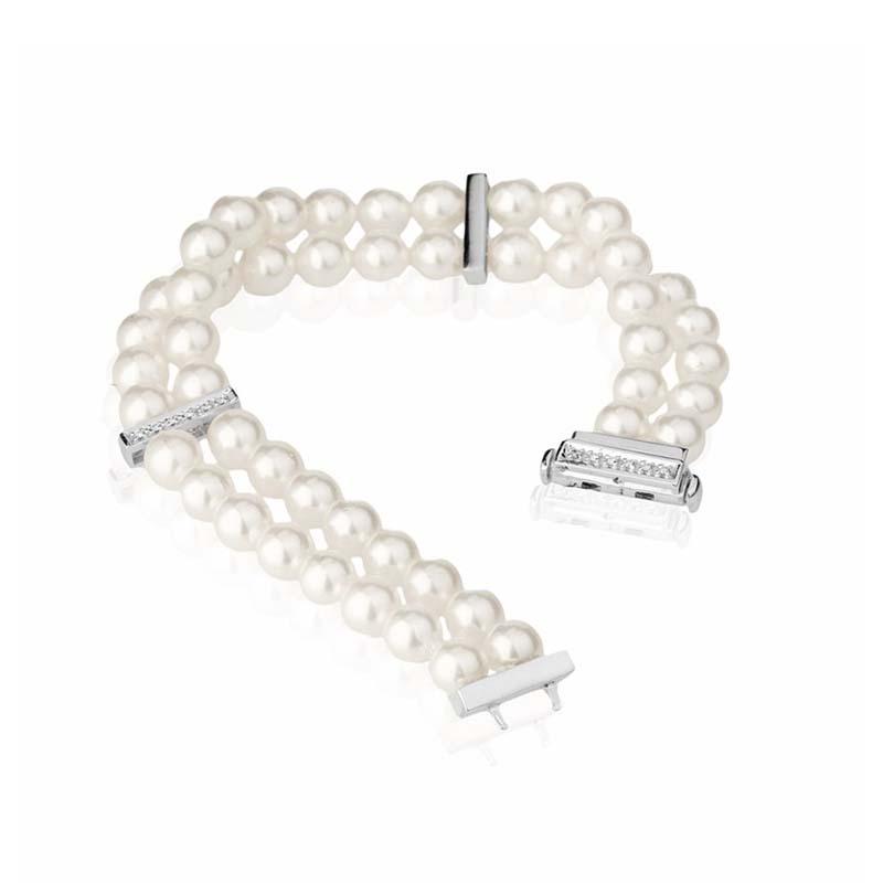 Bracciale in oro bianco con perle e diamanti