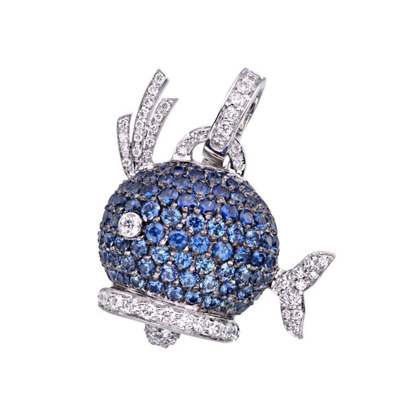 Whale charm set in white gold, blue sapphires and diamonds