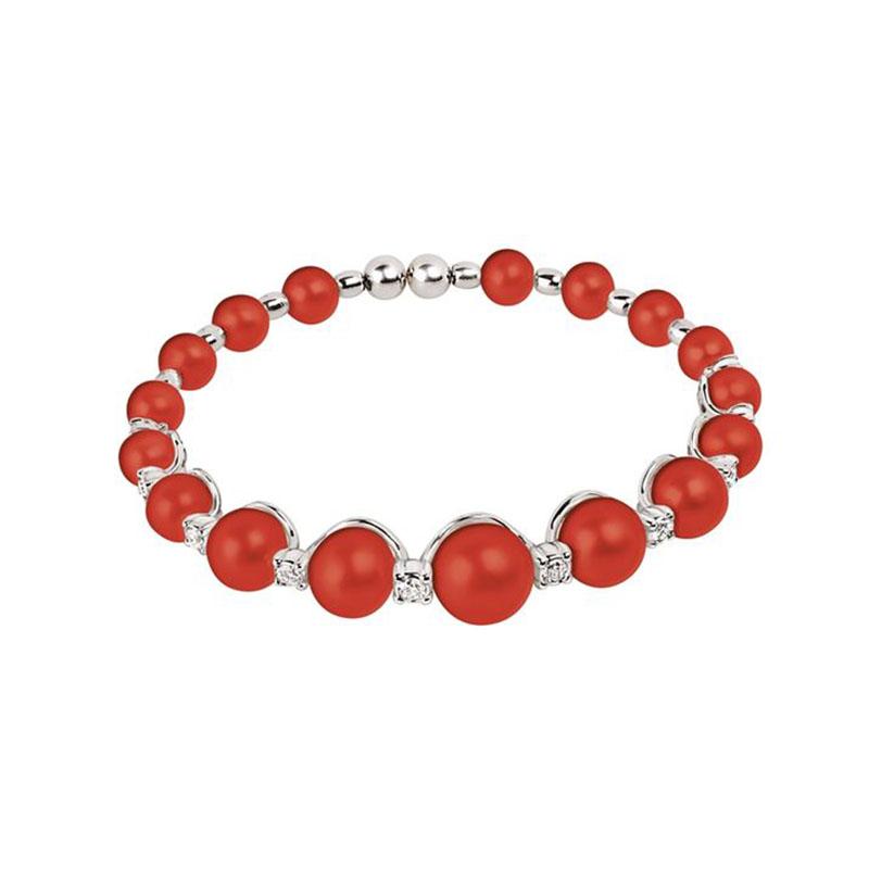Bracciale in oro bianco, diamanti e sfere di corallo rosso